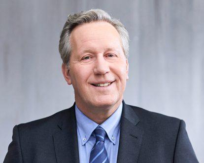 Portrait photo of Michael Schneider, Managing Director, INTREAL