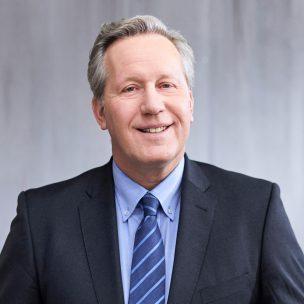 Portraitfoto von Michael Schneider, Geschäftsführer INTREAL